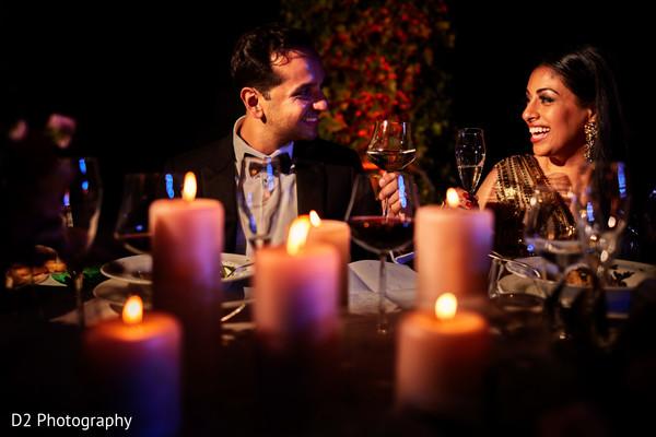 Indian couple enjoying their wedding reception