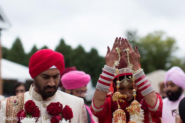 Indian bride throws rice behind her