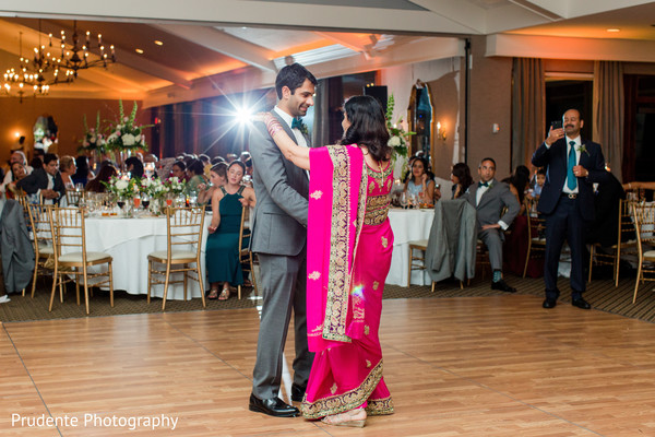 Charming indian groom dancing with his mother