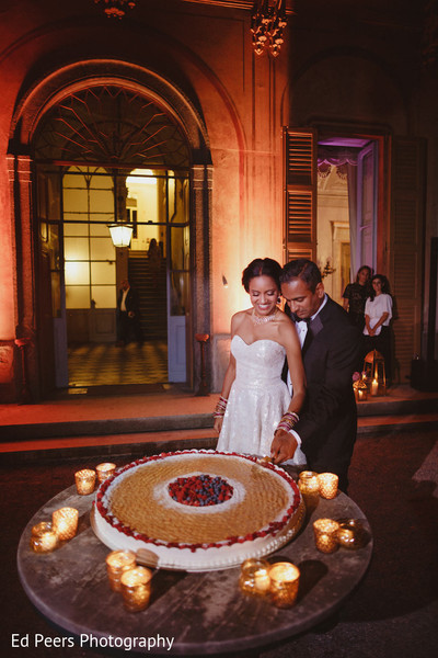 Cutting the cake moment in Lake Como, Italy Indian Wedding by Ed Peers Photography