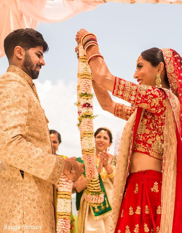 Indian bride and groom's traditional jai mala ritual