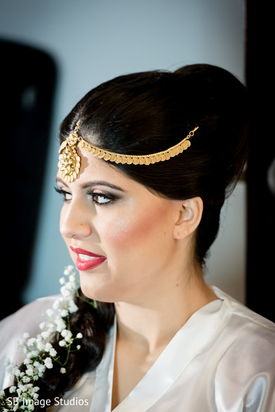 Lovely indian bride getting ready