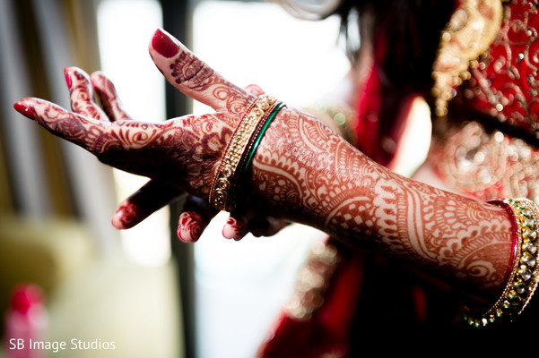 Sweet indian bride putting bangles on
