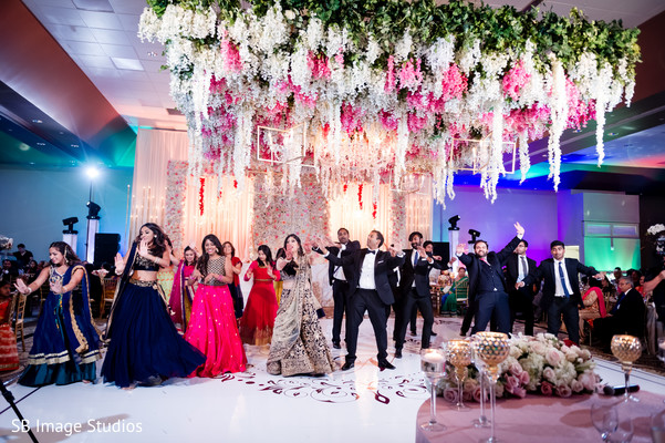Vibrant indian wedding reception dance performance