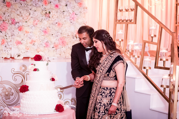 Indian wedding cutting the cake scene in Montgomery, Texas Indian Wedding by SB Image Studios