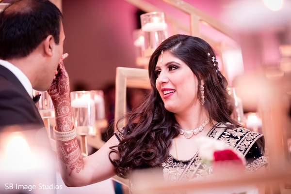 Lovely cake cutting scene in Montgomery, Texas Indian Wedding by SB Image Studios