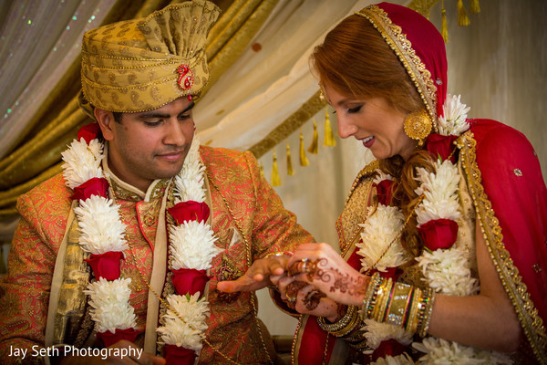 Indian couple exchanging wedding bands