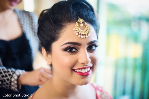 indian bride getting ready,bridal tikka,indian bride hair and makeup