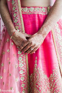 Beautiful indian bride showing henna art.