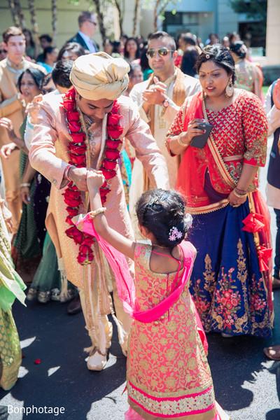 Indian groom joyful moment during baraat.