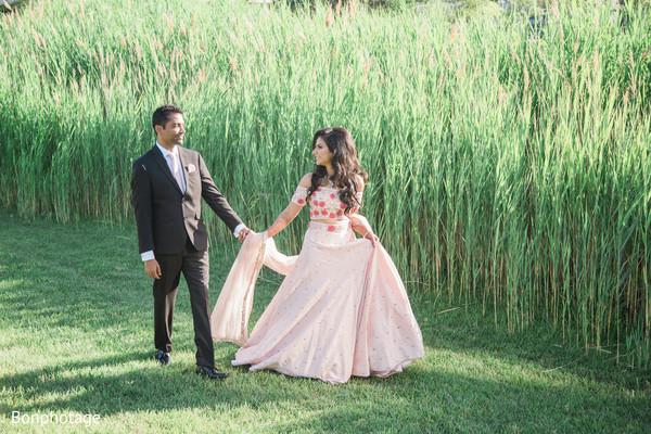 Indian newlyweds walking outdoors