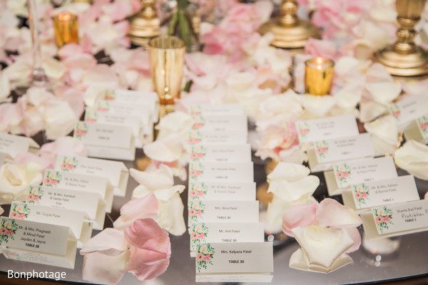 Indian wedding place card table roses decoration.