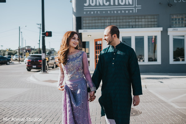 Cute indian couple walking holding hands