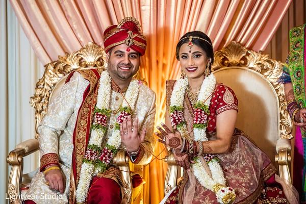 Enchanting indian couple showing wedding rings