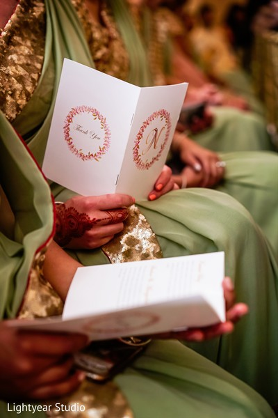 Indian bridesmaids holding wedding program photography