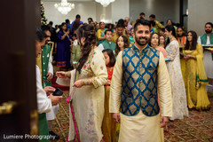 Joyful Indian groom on his sangeet sherwani.