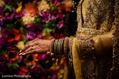 Elegant Indian bride bangles and mehndi art.