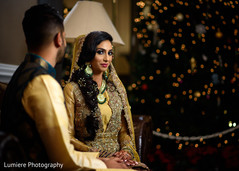 Indian groom admiring beautiful bride.