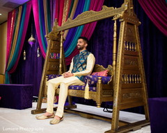 Indian groom waiting for bride at the sangeet celebration.