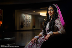 Dreamy Indian bride on her ceremony outfit portrait.