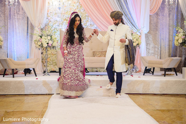 Lovely Indian couple during their wedding ceremony capture. in Bensenville, Illinois Indian Wedding by Lumiere Photography