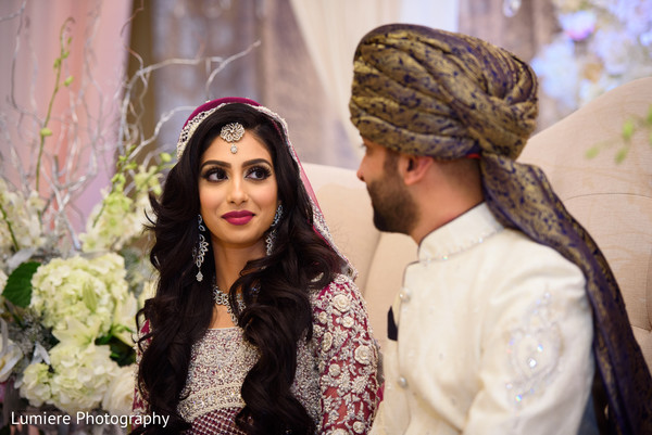 So in love Indian couple looking at each other during wedding ceremony.