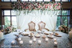 Enchanting Indian bride and groom reception table decoration.