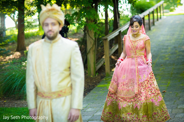 Gorgeous Indian bride walking to find his groom.