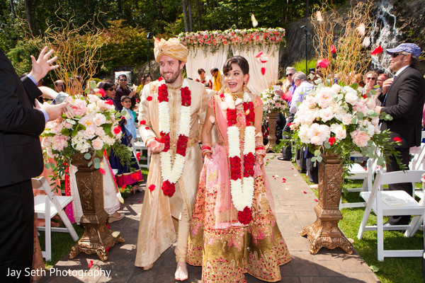 Traditional Indian bride and groom's jai mala ceremony,