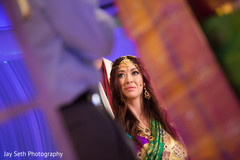stunning Indian bride capture during wedding ceremony.