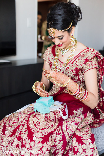 Indian bride opening gift
