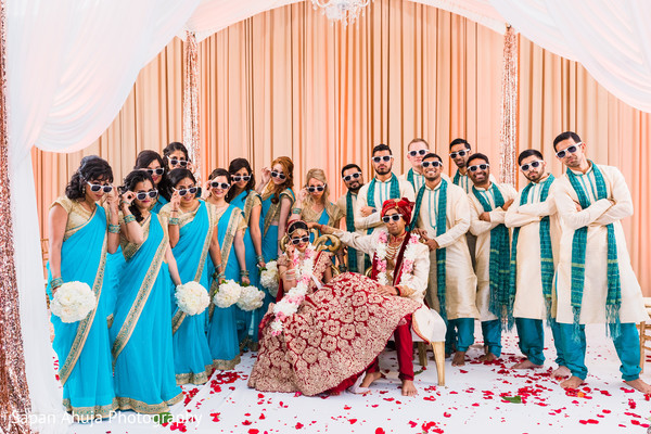 Vibrant portrait of indian bride and groom with bridesmaids and groomsmen