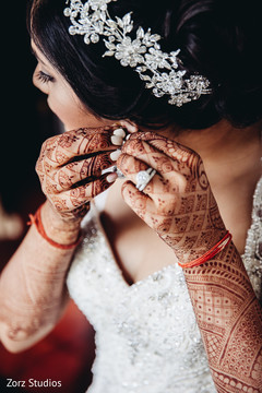 Sweet indian bride getting ready for reception