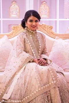 Stunning Indian bride on her wedding reception dress.