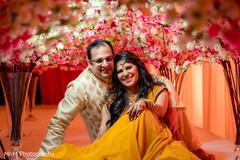 Lovely indian couple  under flower arrangements