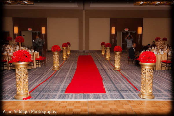Red and gold indian wedding aisle