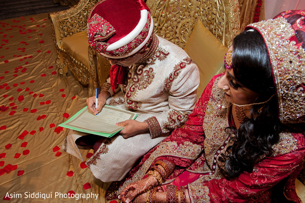 Indian groom signing his contract
