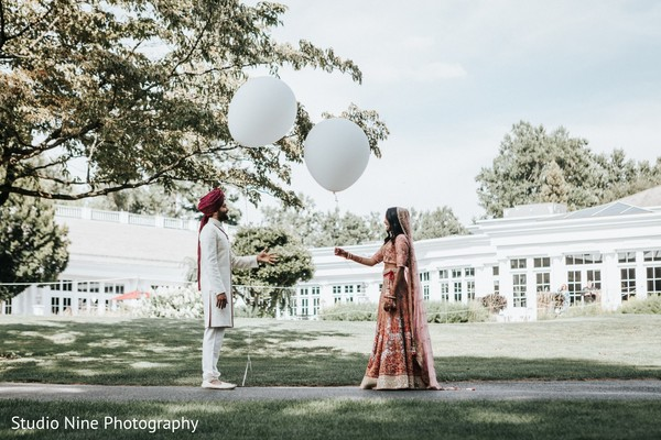Indian bride and groom loving moment.