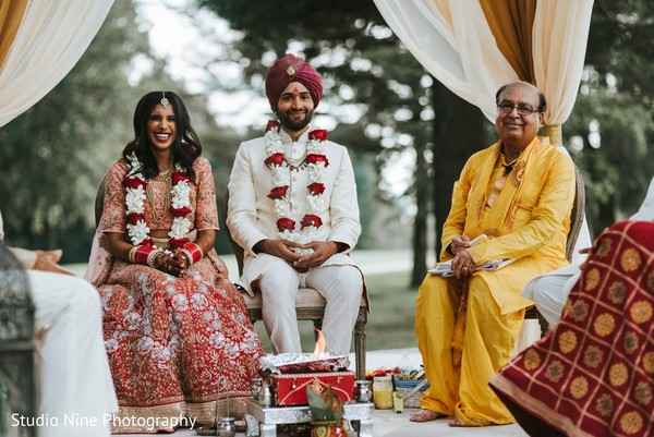 Dazzling Indian bride and Groom  posing at their wedding ceremony.