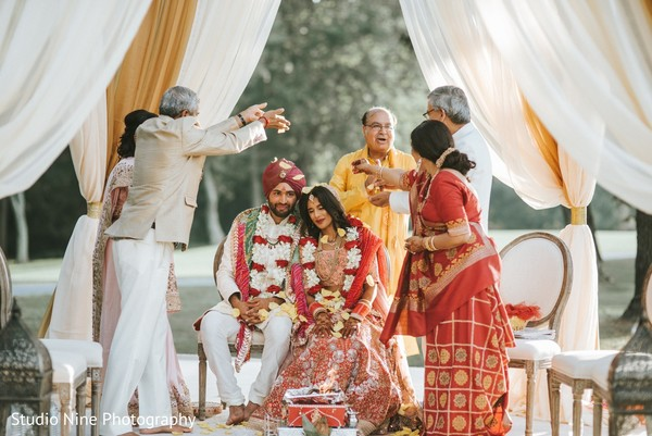 Lovely Indian couple getting blessed by parents at the wedding ceremony.