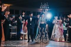 Elegant Indian bride and grooms entrance to wedding reception capture.