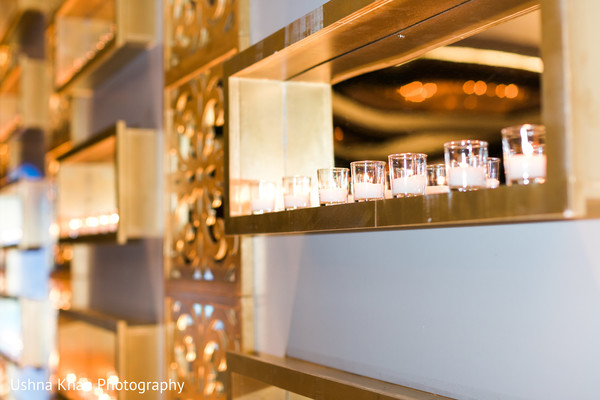 Dreamy mandap mirror and candle decoration.