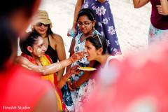 Joyful indian bride's pre-wedding ritual