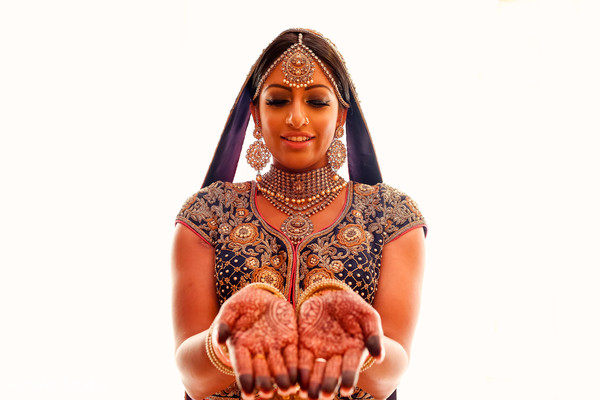 Indian bride showing mehndi art