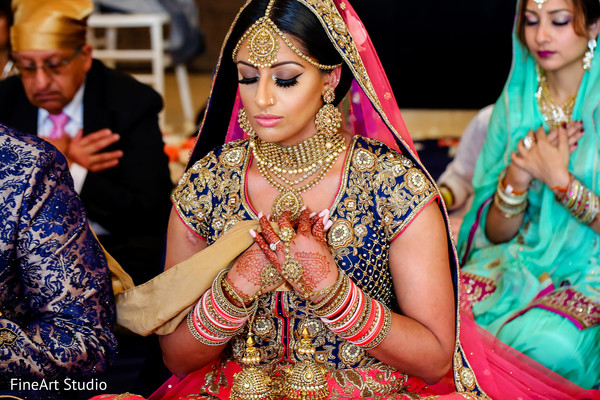Indian bride praying at her wedding ceremony in Cancun, Mexico Destination Sikh Wedding by FineArt Studio