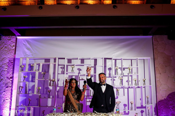 Indian newlyweds toasting in Cancun, Mexico Destination Sikh Wedding by FineArt Studio