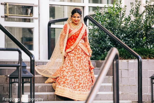 Beautiful indian bride walking down the stairs