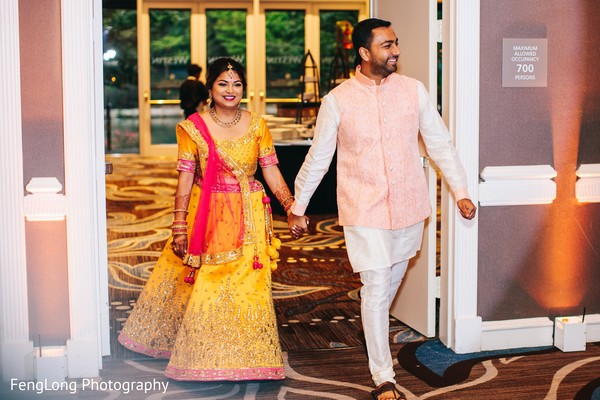 Indian lovebirds' entrance to sangeet