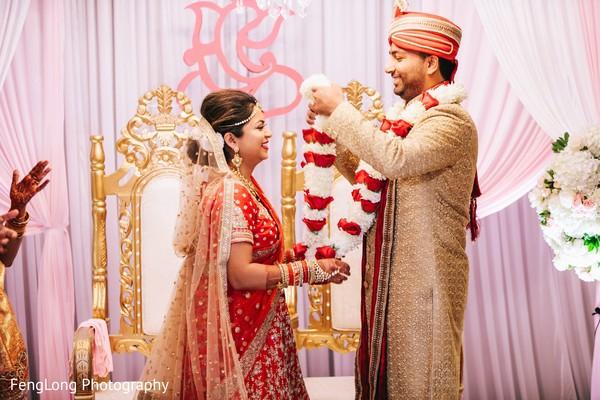 Traditional jai mala ritual in Atlanta, GA Indian Wedding by FengLong Photography