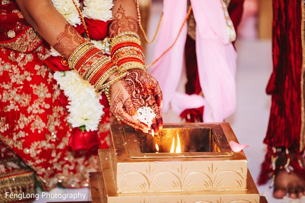 Indian bride making offerings capture in Atlanta, GA Indian Wedding by FengLong Photography